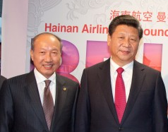 HNA Group Co. Chairman Chen Feng (陈峰) photographed beside Chinese President Xi Jinping