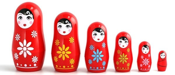 Photo of Matryoshka Dolls Separated and Arranged by Height